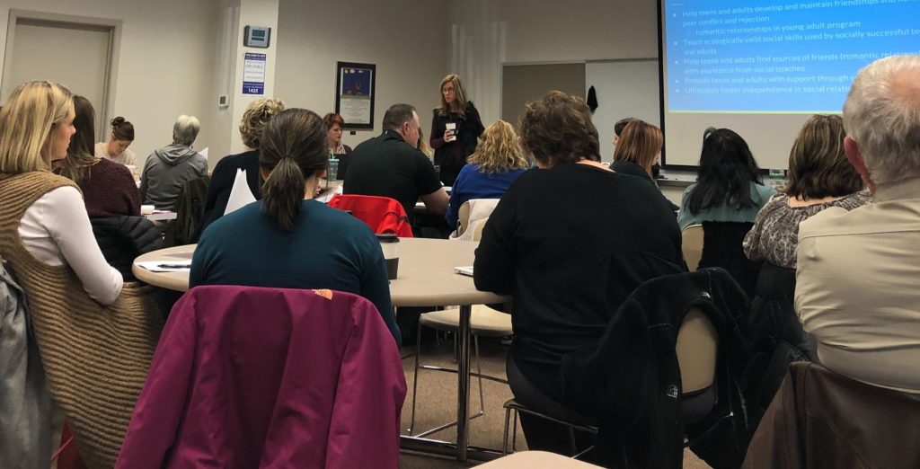 Attendees of PEERS training event watch presentation on Monday, December 9, 2019.